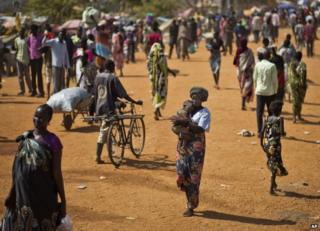 People walk through a camp for displaced people in Juba, South Sudan, 27 December