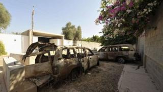 Remains of cars destroyed during the 11 September 2012 attack on the US mission in Benghazi