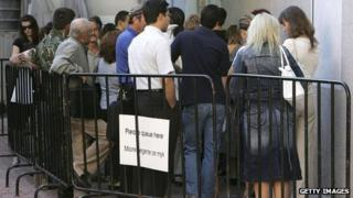 Bulgarians queue outside the British Embassy in Sofia to apply for visas to work in the UK