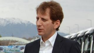 BBC Persian's Fardad Fahrazad meets Babak Zanjani in a car park in Dushanbe