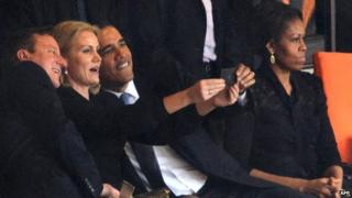 Barack Obama and David Cameron pose for a selfie picture with Denmark's Prime Minister Helle Thorning Schmidt in Johannesburg (December 10, 2013)