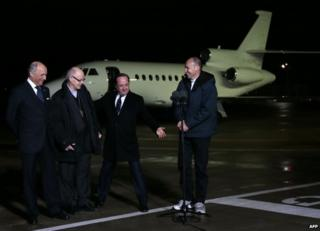 From right: Fr Georges Vandenbeusch, French President Francois Hollande, Bishop Gerard Daucourt and Foreign Minister Laurent Fabius at Villacoublay air base, near Paris, 1 January