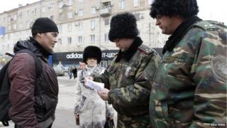 Cossacks check man's papers during street patrol in Volgograd, 2 Jan 14
