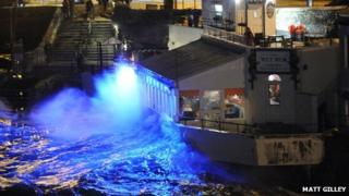 Waves crash over a Plymouth seafront restaurant