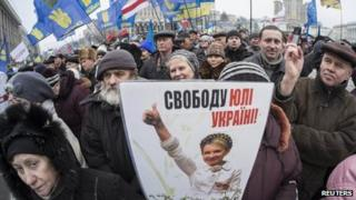 Pro-European integration supporters hold a image of jailed opposition leader Yulia Tymoshenko during a rally in Independence square in central Kiev 5 January 2014
