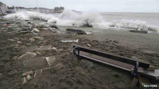 A large wave crashes over the promenade at high tide in Aberystwyth