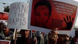 activists during a rally to protest against the gangrape and murder of a teenager in Kolkata on January 5, 2014.