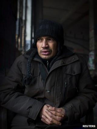 Bulgarian Roma man Dimitar Todorov sits in his squat in Berlin, 4 December 2013