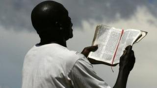 A man in Malawi reads from a bible
