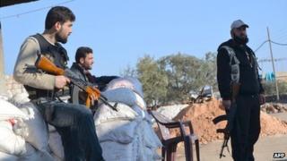 Rebel fighters man a checkpoint close to Jabal al-Zawiya in Idlib province on 6 January 2014