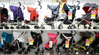 Pushchairs on sale at a Mothercare store