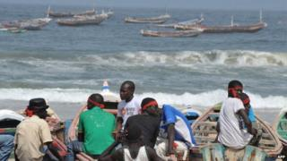 Senegalese fishermen and boat owners wear red headbands in sign of protest as they sit on the beach on 31 March 2011 in Kayar, 52kms(32 miles) north-west of Dakar, during a demonstration against the presence of foreign ships