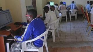 People use computers at an internet cafe in the Hodan area of Mogadishu, 9 October 2013