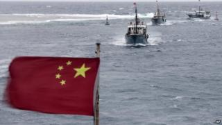 Chinese fishing boats sail off Hainan in the South China Sea on 20 July 2012
