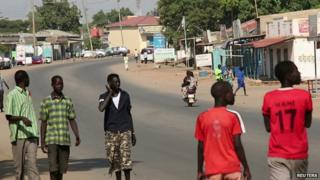 South Sudanese people walk along a street in capital Juba December 16, 201