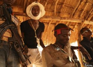 Christian vigilantes rest in Bangui's Ouengo district, 12 January