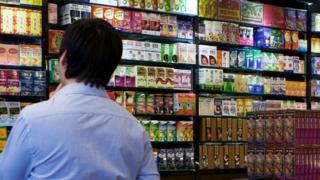 A man at an independent drug store in Hong Kong