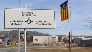 Catalonia flag and roadsign