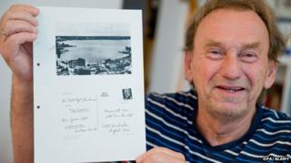 Guenter Zettl with a page from his Stasi file