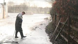 Man with pressure hose