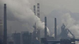Smoke rises from chimneys and facilities of steel plants in Benxi, China. Photo: November 2013
