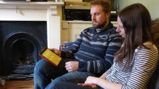 Will and Lydia Moore with tablet