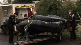 Emergency services prepare their boat