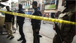 Security officials cordon off the site of a suicide blast in Rawalpindi, 20 January 2014