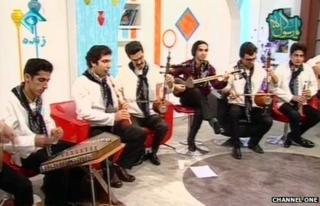 A group of musicians and their instruments on Iranian TV