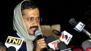 Delhi's Chief Minister Arvind Kejriwal addresses media at the venue of his sit-in protest in New Delhi on January 21, 2014