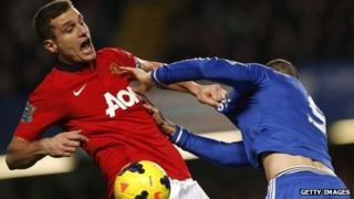Manchester United's Serbian defender Nemanja Vidic (l) clashes with Chelsea's Fernando Torres