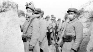 French troops wearing the primitive veil respirators