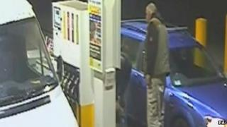A jury was shown footage of two men at a petrol station