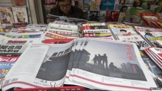 Southern Weekly newspaper copies are left on display at a newsstand in the southern Chinese city of Guangzhou, 7 January 2014.