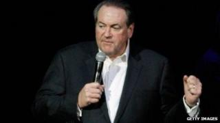 Mike Huckabee speaks on stage in Nashville on November 22, 2013.