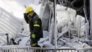 Police investigator in the rubble of fire-hit retirement home in L'Isle-Verte, Quebec (24 Jan)