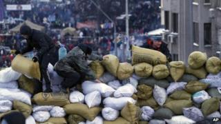 Activists build a barricade in central Kiev, Ukraine, Sunday Jan. 26, 2014.