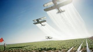 Planes dusting crops with pesticides