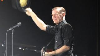 Canadian musician Bryan Adams waves to the crowd before performing at the Harare International Conference Centre in Zimbabwe - 24 January 2014