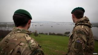 Two commandoes look out over flooded fields