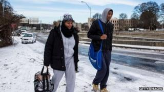 Two high school students walk along a frozen Atlanta highway on January 29, 2014.