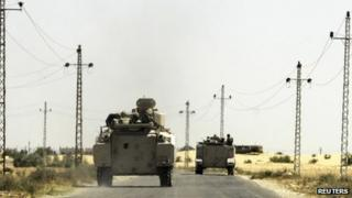 Soldiers in military vehicles travel towards al-Jura district in El-Arish city from Sheikh Zuwaid in the Sinai peninsula in Egypt on 21 May 2013