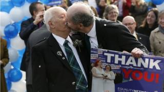 Larry Lamont and Jerry Slater (R) take part in a symbolic same-sex marriage outside the Scottish Parliament in Edinburgh