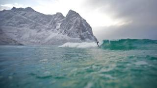 Surfer in a still from film North of the Sun
