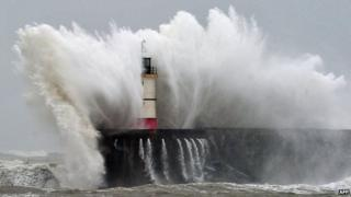 Newhaven Lighthouse is battered by waves during stormy weather on 5 February