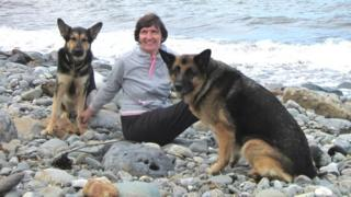 Prof Anna Lawson with dogs on beach