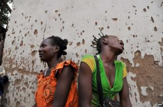 Women mourn for two relatives killed in Bangui's 5th district, CAR, 9 February