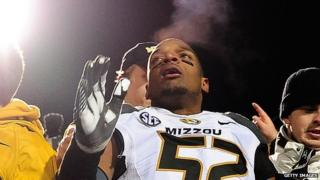 Missouri defensive lineman Michael Sam jumps into the stands at the end of a football game on November 23, 2013.