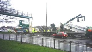 Collapsed footbridge after being hit by lorry