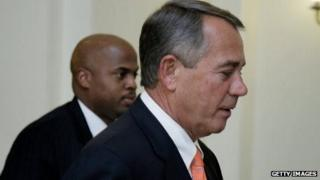 Speaker John Boehner leaves a press conference after the House of Representatives voted to increase the US borrowing authority on 11 February, 2014